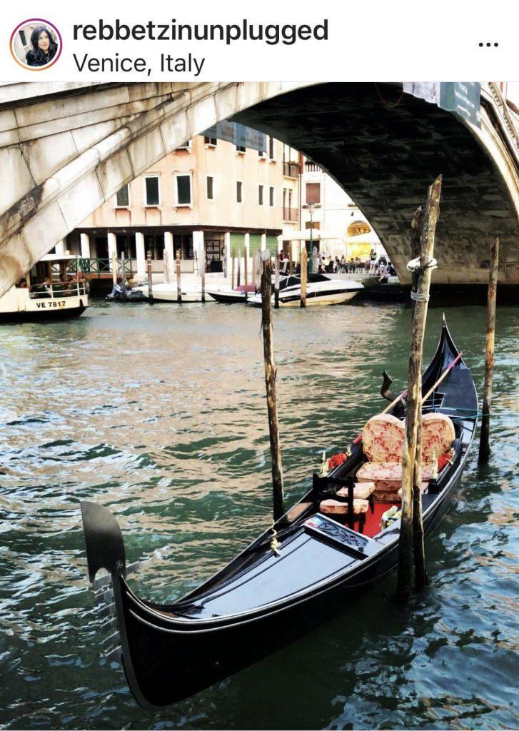 gondola near a bridge on the Grand Canal of Venice, Italy