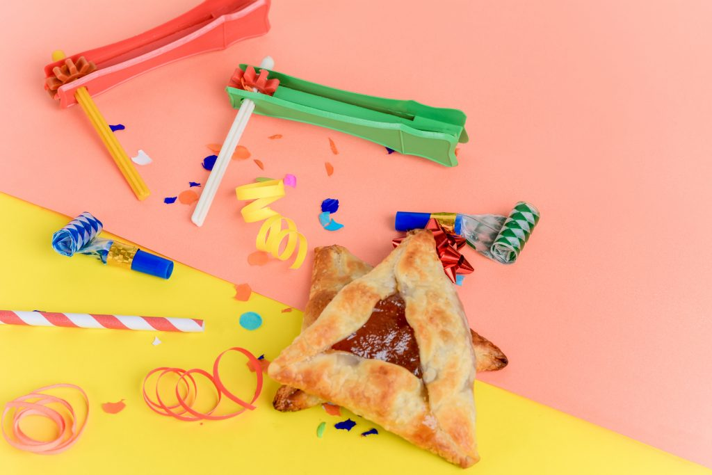 Purim Background with party costume and hamantasch